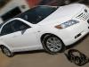 Обтяжка чёрной глянцевой плёнкой крыши, обтяжка плёнкой под карбон зеркал Toyota Camry